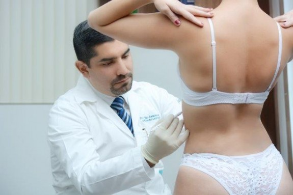 Dr. Salamea consulting with a client.