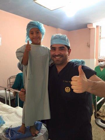 Dr. Salamea with a happy patient.