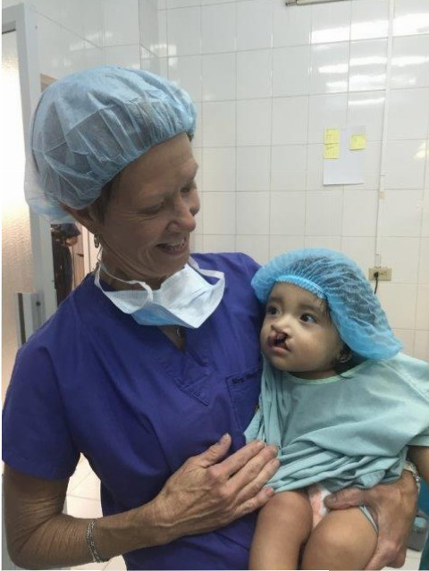 Mary Freeman with a patient prior to surgery.